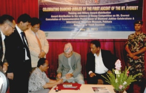 Minister affixing the first cancellation mark on the stamp. Photo: Nepal Mountain Focus
