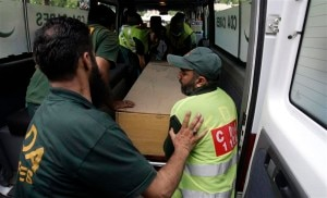 Hospital staff and rescue workers move the body of one of the nine foreign tourists killed by unidentified gunmen near the Nanga Parbat peak, from an ambulance to a hospital morgue in Islamabad. REUTERS
