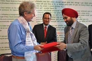 Director General of ICIMOD Dr David Molden and Country Manager of Dabur Nepal HS Bedi exchanging the MoU, in Kathmandu, on Wednesday, June 19, 2013. Photo: Nepal Mountain Focus