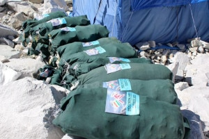 Bags of garbage collected by the team sit at a base camp along the trail. Over 4,000kg of garbage was collected. Photo: Courtesy of Nepal Army