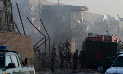 Security guards gather at the bombed entrance gate of a foreign logistics company, in Kabul, on July 2, 2013. Photo: AFP