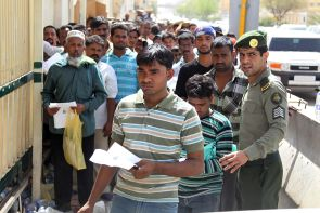 Illegal immigrant workers wait in line at the Saudi immigration offices in Riyadh. Photo: Agency