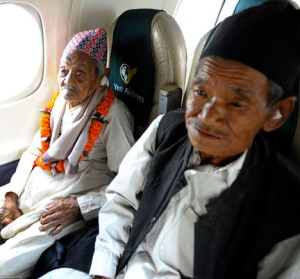 Elderly Bote Rai (left ), 106, sits in the window seat accompanied by his nephew Man Bahadur Rai who is himself 75 years old, in his unique journey of a Yeti Airlines aircraft. Photo: Yeti Air