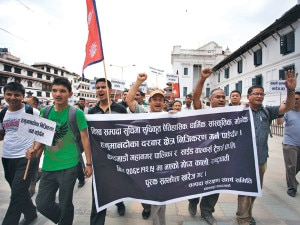 Locals of Basantapur and supporters stage protest rally against the KMC decision in Kathmandu Durbar Square. Photo: Kantipur
