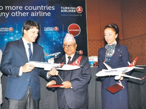 Official of Turkish Airline handing over the airplane to the Director general of the Civil Aviation Authority of Nepal Ratish Chandra Lal Suman during inauguration of flights of the airline in Nepal on Monday, September 02, 2013.