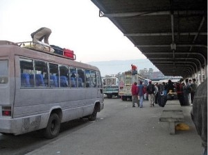 A staff manage the belongings of passengers on the hoot of the bus at New Bus Park in Kathmandu. With the festive season approaching rush at the bus park that connect all most all the Nepal districts with capital city is seen. Photo: File photo