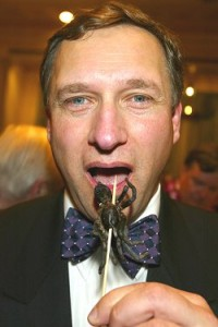 David Hemplemen Adams is tempted by the glazed- tarantula hors d'oeuvres on offer at the Explorer's Dinner in New York 2004. Photo: Stuart Conway - The Telegraph
