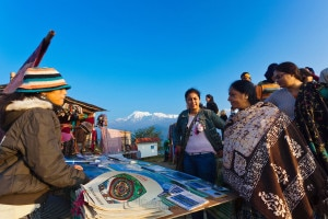 A group of Indian tourists bargaining  with a local vendor at Sarangkot, a popular tourist destinations for Sunrise and Sunset views at Pokhara. Photo: File photo