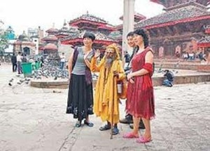 Chinese tourists taking photo with a holy sage in the Kathmandu Durbar Square. Photo: File photo