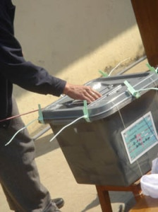 In this file photo taken during the first elections of the Constituent Assembly held on 2008, a man is seen casting his vote in the ballot box.