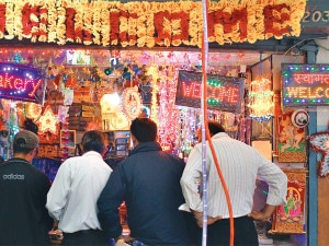 Buyers checking for electric lamps for Tihar at a shop in Mahabouddha, Kathmandu. Photo: NMF