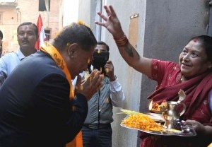 Candidate of the Nepali Congress party for Kathmandu constituency No. 1, Prakash Man Singh Shrestha, greet a woman who bless him during door-to-door poll campaign in Kathmandu. Photo: NMF