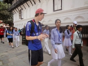 Foreign tourist interacts with a student during their visit to the Hanuman Dhoka Palace Museum in Kathmandu Durbar Square, Basantapur, Kathmandu. Photo: NMF