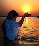 A devotee offering prayer to setting sun, file photo.