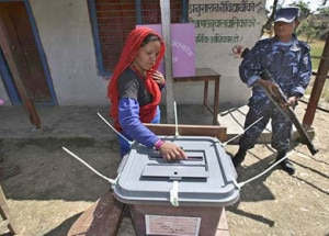 Woman casting a vote in second CA polls held on November 19.