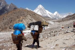 Porters carrying loads to the Everest Base Camp. Photo: alanarnette.com