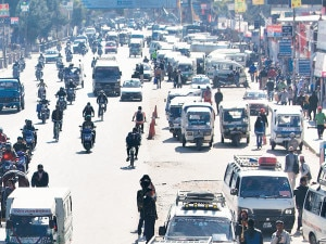 Public vehicles waiting for passengers at Sundhara, Kathmandu. Vehicles defy a transport strike called by the poll-opposing 33-party alliance on Wednesday.