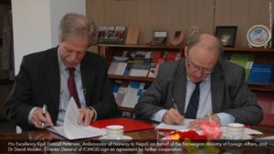 Ambassador of Norway to Nepal Kjell Tormod Pettersen (left)and Dr David Molden of ICIMOD signing the deal