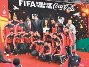 Nepali national football team members posing for a photograph with the trophy.