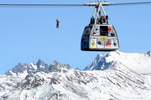 The crew watches on as Mr Millot balances precariously on the thin wire hundreds of feet above the Alps. Photo: dailymail.com