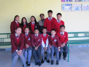 Students pose for photo with hostel warden. Photo: NMF.