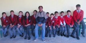 Students pose for photo with their hostel warden KB Thapa (center). Photo: NMF