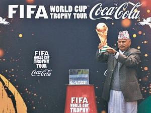 President Ram Baran Yadav holds the Fifa World Cup trophy at the Dashrath Stadium in Kathmandu on Saturday.