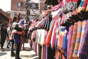 A woman looks for the shawls being put for selling at Indrachowk, the central marketplace in Kathmandu. With the  onset of winter mercury of Kathmandu has also dipped. Photo: NMF