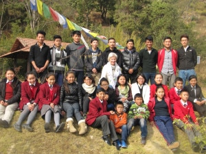 Fabienne Clausse with students during a picnic programme organized recently in Kathmandu. Photo: NMF