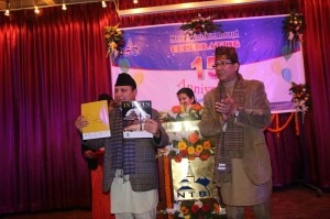 Minister for Culture, Tourism and Civil Aviation Mr. Ram Kumar Shrestha releasing In Focus, NTB's souvenir on the occasion of its 15th anniversary on January 9, 2014. Photo: NMF