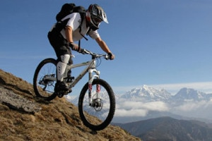 A foreigner enjoys mountain biking at tourist hub city Pokhara, located at western province in Nepal. File Photo:www.turrettours.com.