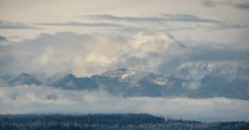 Puget_sound_cascade_mountains_and_rain_clouds-300x161.jpg