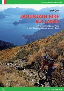 "Photo of In bici in Lombardia, la guida ""Mountain bike sui laghi"""