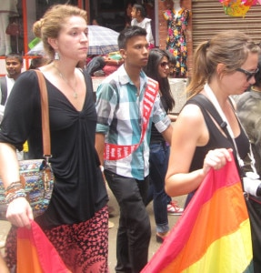In this file photo taken a year ago two women tourist seem walking acrossing the streets in the capital Kathmandu, Nepal. Image source: NMF/file.
