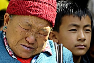 In this handout file photograph received from RSS (National News Agency) on April 19, 2014, the mother of Mount Everest avalanche victim Ang Kazi Sherpa weeps as she waits for the body of her son to arrive at Sherpa Monastery in Kathmandu.