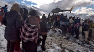Waiting for help: A Nepalese army helicopter rescues survivors. Photo courtesy to AFP.